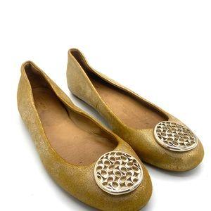 COACH Golden Slip ons